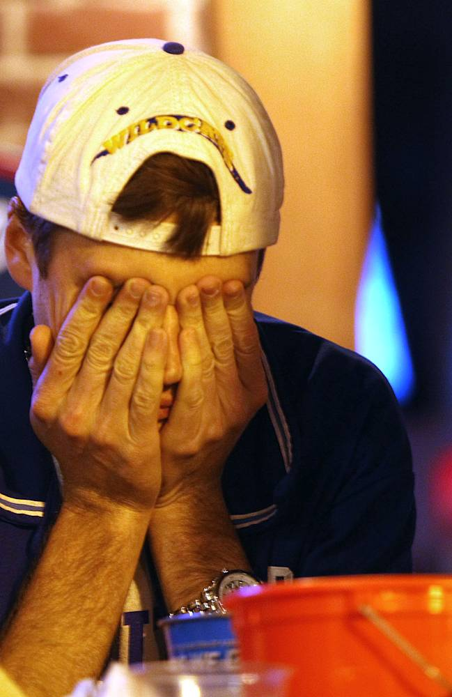 A Kentucky fan reacts in Lexington, Ky. to Kentucky losing to UConn in the NCAA championship game Monday April 7, 2014
