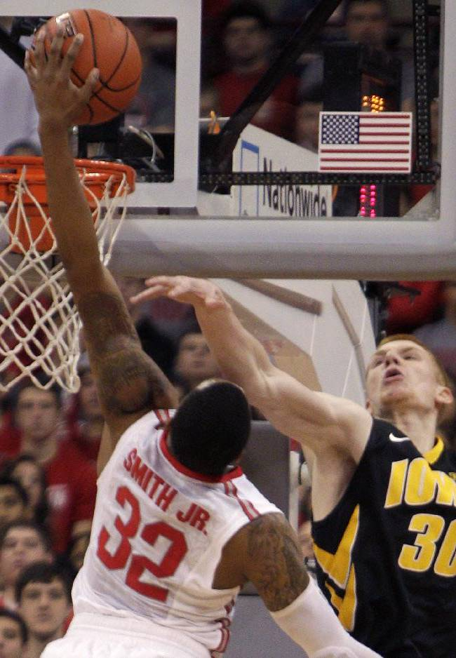 Ohio State's Lenzelle Smith, left, tries to dunk the ball over Iowa's Aaron White during the first half of an NCAA college basketball game on Sunday, Jan. 12, 2014, in Columbus, Ohio