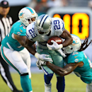 Miami Dolphins defensive end Derrick Shelby (79), left, and free safety Louis Delmas (25) tackle Dallas Cowboys running back DeMarco Murray (29) during the first half of an NFL preseason football game, Saturday, Aug. 23, 2014, in Miami Gardens, Fla The As