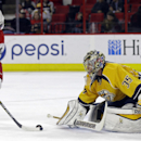 Carolina Hurricanes' Eric Staal (12) tries to score against Nashville Predators goalie Pekka Rinne (35), of Finland, during the second period of an NHL hockey game in Raleigh, N.C., Tuesday, Dec. 2, 2014 The Associated Press