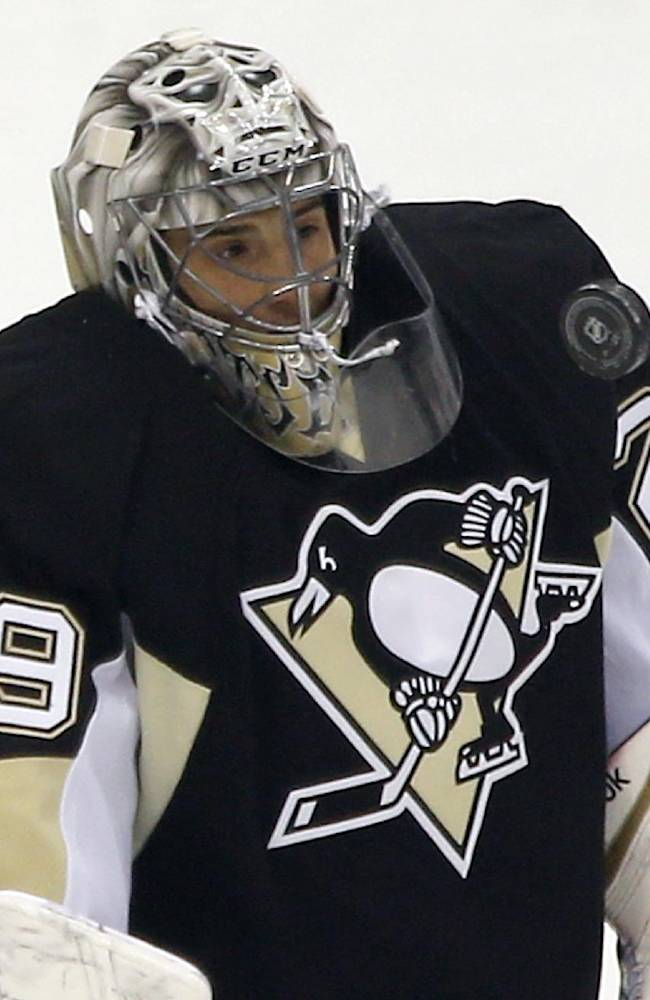 Pittsburgh Penguins' Marc-Andre Fleury (29) makes a save during the first period of an NHL hockey game against the Montreal Canadiens, Thursday, Feb. 27, 2014 in Pittsburgh