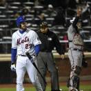 New York Mets' Ike Davis (29) walks back to the dugout after striking out as Atlanta Braves catcher Brian McCann signals two outs in the eighth inning of a baseball game at Citi Field on Saturday, May 25, 2013, in New York. The Braves won 6-0. (AP Photo/Kathy Kmonicek)