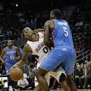 Atlanta Hawks point guard Jeff Teague (0) is fouled by Oklahoma City Thunder center Kendrick Perkins (5) in the first half of an NBA basketball game Tuesday, Dec. 10, 2013, in Atlanta The Associated Press