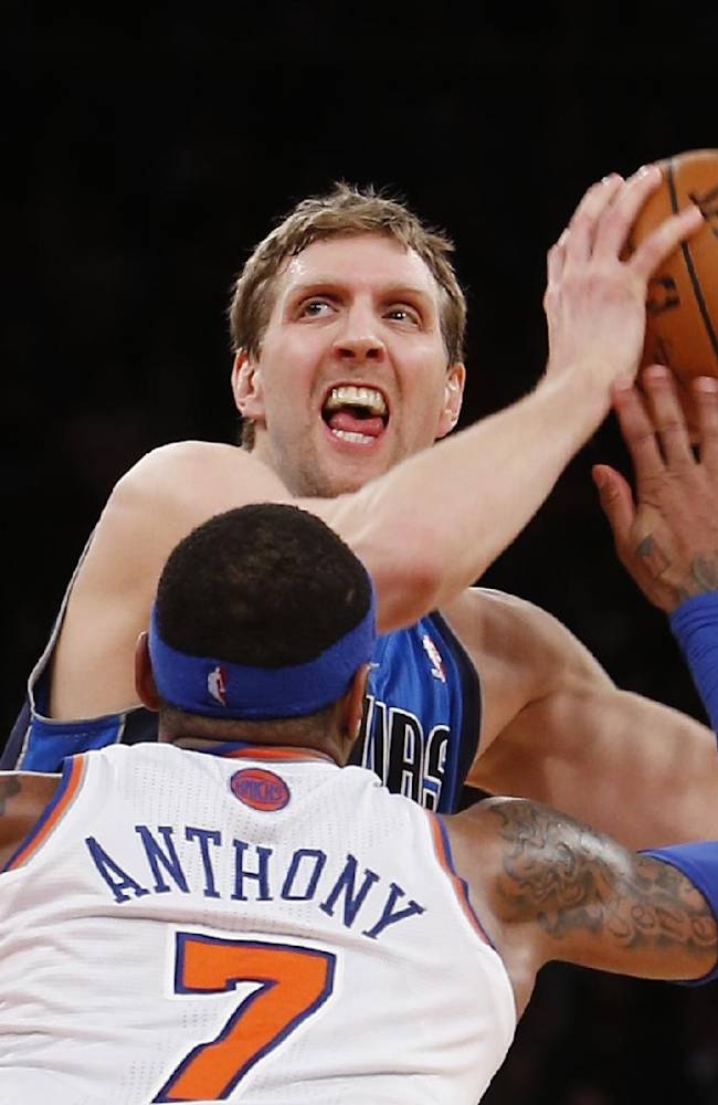 Dallas Mavericks' Dirk Nowitzki works to get open before shooting the game-winning basket against New York Knicks' Carmelo Anthony (7) in the final seconds of an NBA basketball game Monday, Feb. 24, 2014, in New York.  Dallas won 110-108