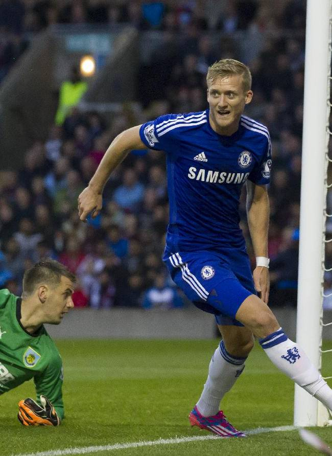 Chelsea's Andre Schurrle celebrates after scoring past Burnley goalkeeper Tom Heaton during their English Premier League soccer match at Turf Moor Stadium, Burnley, England, Monday Aug. 18, 2014