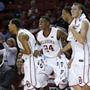 Oklahoma players, from left, Isaiah Cousins, Buddy Hield, TaShawn Thomas and Ryan Spangler celebrate on the bench late in the second half of an NCAA college basketball game against Texas Tech in Norman, Okla., Wednesday, Jan. 28, 2015. Oklahoma won 81-36. (AP Photo/Sue Ogrocki)