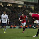 Manchester United's Wayne Rooney scores a penalty during the English FA Cup Fifth Round soccer match between Preston and Manchester United at Deepdale Stadium in Preston, England, Monday Feb. 16, 2015. (AP Photo/Jon Super)