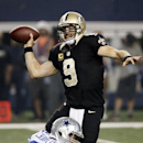 New Orleans Saints quarterback Drew Brees (9) passes under pressure from New Orleans Saints outside linebacker Parys Haralson (98) during the first half of an NFL football game, Sunday, Sept. 28, 2014, in Arlington, Texas. The Associated Press