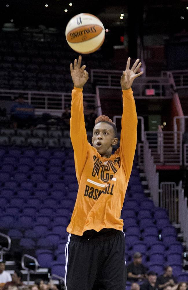WNBA ALL-Stars West conference Danielle Robinson, of the San Antonio Spurs, takes a shot during a group shoot during an open practice at US Airways Center, Friday, July 18, 2014 in Phoenix