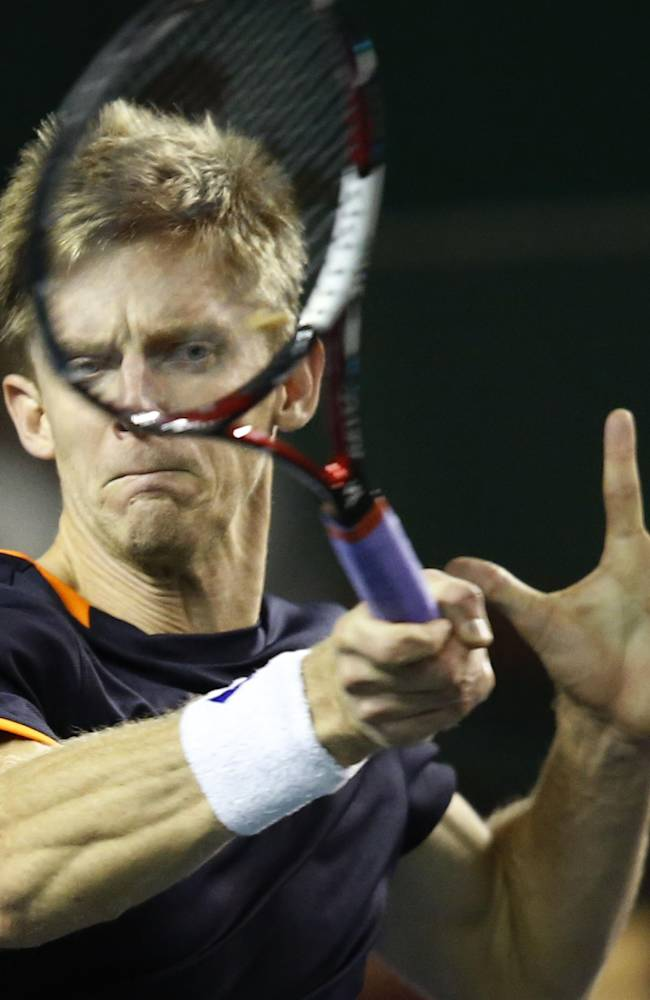 South Africa's Kevin Anderson, retruns the ball to Colombia's Santiago Giraldo during their first round match at the ATP World Tour Masters tennis tournament at Bercy stadium in Paris, France, Tuesday, Oct. 28, 2014. Anderson won 6-4, 7-6(8)