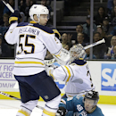 Buffalo Sabres goalie Michal Neuvirth (34) falls on San Jose Sharks' Tomas Hertl (48) during the second period of an NHL hockey game Saturday, Oct. 25, 2014, in San Jose, Calif. At left, Rasmus Ristolainen (55) defends on the play The Associated Press