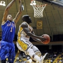 Southern Mississippi guard Jerrold Brooks (23) shoots against Louisiana Tech forward Michale Kyser (1) in the first half of their NIT college basketball game in Hattiesburg, Miss., Monday, March 25, 2013. (AP Photo/Rogelio V. Solis)