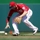 Washington Nationals second baseman Danny Espinosa cannot handle a hit by Atlanta Braves' Jason Heyward during the first inning of a baseball game at Nationals Park, Sunday, April 6, 2014, in Washington. Espinosa was charged with an error on the play The
