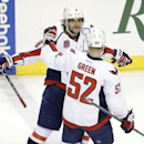 Washington Capitals left wing Alex Ovechkin (8), of Russia, celebrates with teammate Mike Green (52) after scoring his second goal against the Nashville Predators in the second period of an NHL hockey game Friday, Jan. 16, 2015, in Nashville, Tenn The Ass