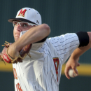 FILE - In this May 31, 2014, file photo, Maryland pitcher Mike Shawaryn delivers during an NCAA college baseball tournament regional game against South Carolina in Columbia, S.C. Shawaryn's 10 wins are tied for most in the nation, and he'll go into his Friday night start against Indiana on a streak of 20 shutout innings. He has struck out 24 since he last walked a batter on April 10. (AP Photo/Stephen B. Morton, file)