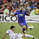 Manchester United's Luke Shaw jumps over Inter Milan's Andrea Ranocchia during the second half of the 2014 Guinness International Champions Cup soccer game, Tuesday, July 29, 2014, in Landover, Md. Manchester United won 5-3 in a penalty kick shootout