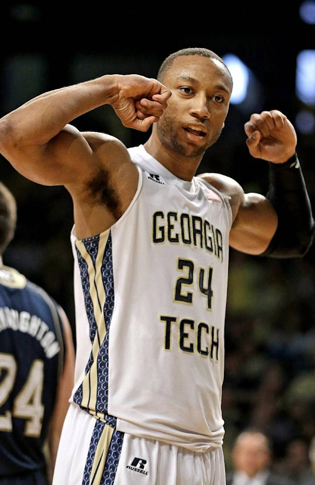 Georgia Tech's Kammeon Holsey gestures after sinking a basket while drawing the foul in the second half of an NCAA college basketball game against Notre Dame, Saturday, Jan. 11, 2014, in Atlanta. Georgia Tech won 74-69