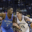 Memphis Grizzlies' Mike Miller (13) drives past Oklahoma City Thunder's Perry Jones (3) in the second half of an NBA basketball game in Memphis, Tenn., Wednesday, Dec. 11, 2013. The Thunder defeated the Grizzlies 116-100 The Associated Press