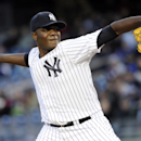 New York Yankees pitcher Michael Pineda delivers the ball to the Chicago Cubs during the first inning of Game 2 of an interleague baseball doubleheader on Wednesday, April 16, 2014, at Yankee Stadium in New York The Associated Press