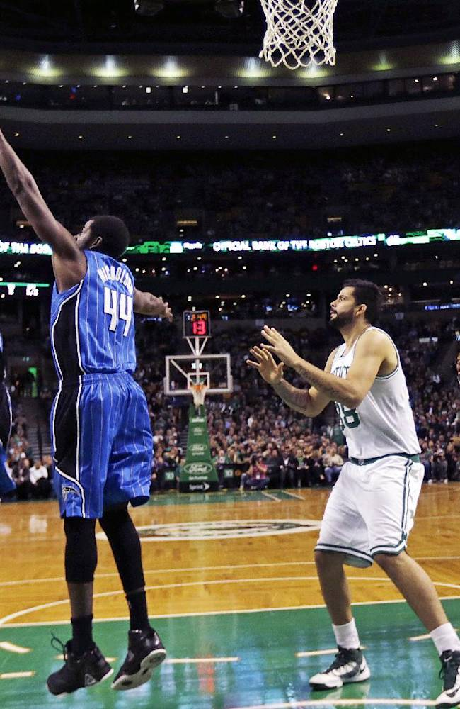 Boston Celtics guard Jordan Crawford (27) drives to the basket against Orlando Magic power forward Andrew Nicholson (44) during the first quarter of an NBA basketball game, in Boston, Monday, Nov. 11, 2013