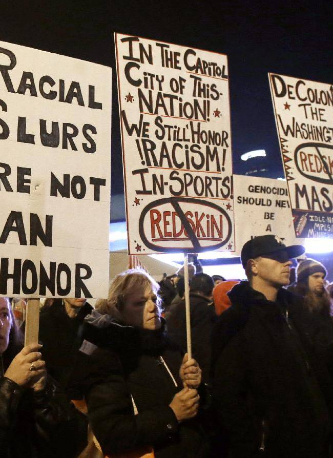 American Indians and their supporters gather outside the Metrodome to protest the Washington Redskins' name, prior to an NFL football game between the team and the Minnesota Vikings, Thursday, Nov. 7, 2013, in Minneapolis