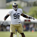 St. Louis Rams defensive end Michael Sam takes part in a drill during training camp at the NFL football team's practice facility Tuesday, July 29, 2014, in St. Louis The Associated Press
