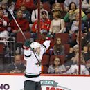 Minnesota Wild's Justin Fontaine celebrates his third goal of the night against the Phoenix Coyotes, for a hat trick, during the third period in an NHL hockey game Thursday, Jan. 9, 2014, in Glendale, Ariz. The Wild defeated the Coyotes 4-1 The Associate