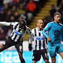 Newcastle United's Papiss Cisse, left, has a shot towards goal past Tottenham Hotspurs' Kyle Walker, right, during their English Premier League soccer match at St James' Park, Newcastle, England, Wednesday, Feb. 12, 2014