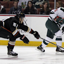 Minnesota Wild left wing Jason Zucker, right, takes a shot on-goal with Anaheim Ducks defenseman Alex Grant (51) defending in the first period of an NHL hockey game on Wednesday, Dec. 11, 2013 in Anaheim, Calif The Associated Press
