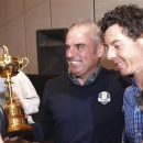 Rory McIlroy, right, congratulates Paul McGinley of Ireland, holding the Ryder Cup, after he was nominated as the Captain for the 2014 European Ryder Cup Team following a meeting of the Tournament Committee of the European Tour in Abu Dhabi, United Arab Emirates, Tuesday, Jan. 15, 2013. (AP Photo/Manuel Salazar)