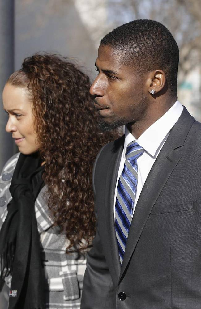 New England Patriots cornerback Alfonzo Dennard and his unnamed girlfriend arrive to the Lancaster County Courthouse in Lincoln, Neb., Friday, Dec. 6, 2013. A drunken-driving charge in Nebraska against Dennard has been dismissed, and he pled no contest to another charge and was fined $500