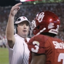 Oklahoma head coach Bob Stoops greets wide receiver Sterling Shepard (3) as he returns to the bench during the second quarter of an NCAA college football game in Norman, Okla., Saturday, Oct. 20, 2012. (AP Photo/Sue Ogrocki)