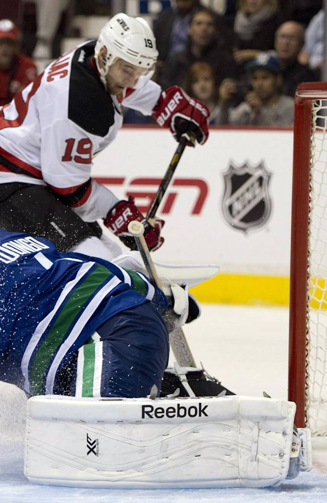 Canucks slip past Devils 3-2 in OT