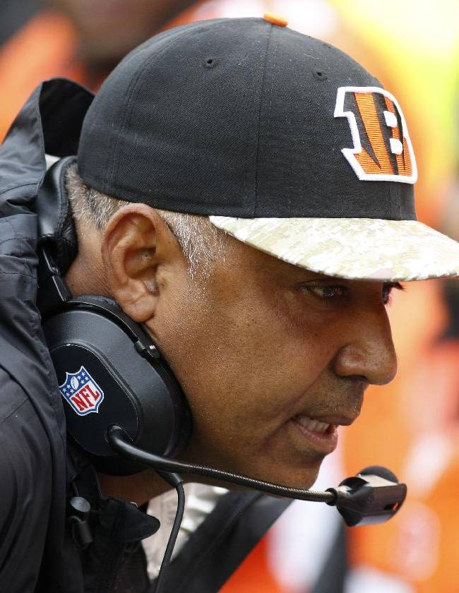 Cincinnati Bengals head coach Marvin Lewis talks on the sidelines in the first half of an NFL football game against the Cleveland Browns, Sunday, Nov. 17, 2013, in Cincinnati