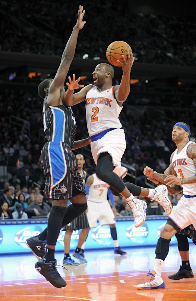 New York Knicks' Raymond Felton (2) goes up to shoot as Orlando Magic forward Andrew Nicholson defends during the second quarter of an NBA basketball game on Friday, Dec. 6, 2013, at Madison Square Garden in New York