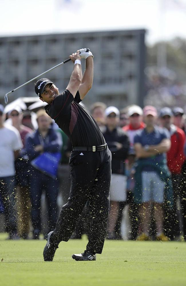 Jason Day of Australia hits an approach shot to the 17th green during the final round of the World Cup of Golf at Royal Melbourne Golf Course in Australia, Sunday, Nov. 24, 2013
