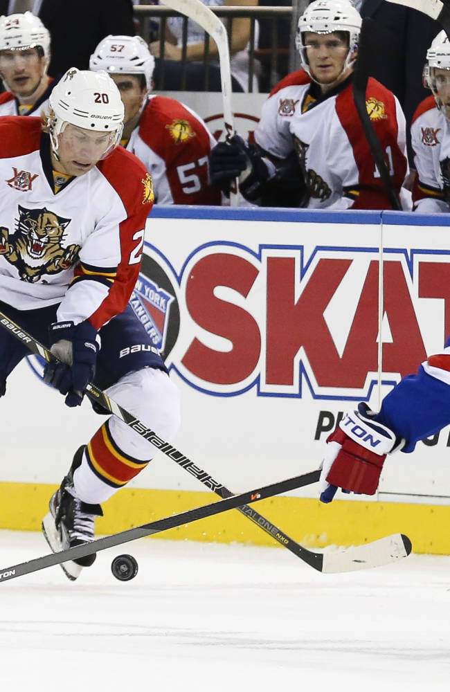 Florida Panthers left wing Sean Bergenheim (20) battles for the puck against New York Rangers defenseman Anton Stralman (6) in the first period of their NHL hockey game at Madison Square Garden, Sunday, Nov. 10, 2013, in New York