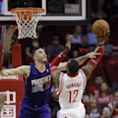 Houston Rockets' Dwight Howard (12) goes up for a shot as Phoenix Suns' Miles Plumlee (22) defends during the first quarter of an NBA basketball game Wednesday, Dec. 4, 2013, in Houston The Associated Press