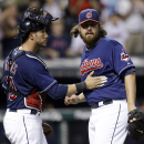 Cleveland Indians catcher Yan Gomes, left, congratulates relief pitcher Chris Perez after the Indians defeated the Baltimore Orioles 6-4 in a baseball game, Wednesday, Sept. 4, 2013, in Cleveland. (AP Photo/Tony Dejak)