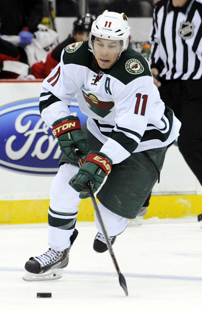 Minnesota Wild's Zach Parise skates in on a breakaway during the first period of an NHL hockey game against the New Jersey Devils, Thursday, March 20, 2014, in Newark, N.J