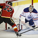 Edmonton Oilers goalie Viktor Fasth, right, stops a shot from Calgary Flames' Devin Setoguchi during the first period of an NHL preseason hockey game in Calgary, Alberta, Sunday, Sept. 21, 2014 The Associated Press