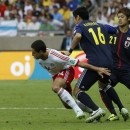 Mexico's Javier Hernandez, left, is challenged for the ball by Japan's Yuzo Kurihara (16) and Japan's Hiroki Sakai during the soccer Confederations Cup group A match between Japan and Mexico at the Mineirao stadium in Belo Horizonte, Brazil, Saturday, June 22, 2013. (AP Photo/Bruno Magalhaes)