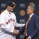 Houston Astros general manager Jeff Luhnow, right, shakes hands with newly-signed pitcher Mark Appel during a baseball news conference Wednesday, June 19, 2013 in Houston, to announce his signing. Appel was selected with the first overall pick in the 2013 MLB First-Year Player Draft. (AP Photo/David J. Phillip)