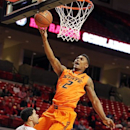 Oklahoma State's Le'Bryan Nash (2) shoots in front of Texas Tech's Josh Gray during their NCAA college basketball game, Wednesday, Feb. 13, 2013, in Lubbock, Texas. (AP Photo/The Avalanche-Journal, Zach Long)
