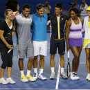 Players from left, Victoria Azarenka of Belarus, France's Jo-Wilfried Tsonga, Switzerland's Roger Federer, Serbia's Novak Djokovic, Serena Williams of the US and Serbia's Ana Ivanoic pose for a group photo following an exhibition match on Rod Laver Arena during the Kids Tennis Day at Melbourne Park ahead of the Australian Open tennis championship in Melbourne, Australia, Saturday, Jan. 12, 2013. (AP Photo/Andy Wong)