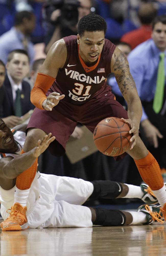 Miami's Davon Reed, bottom, reaches in on Virginia Tech's Jarell Eddie, top, during the first half of a first round NCAA college basketball game at the Atlantic Coast Conference tournament in Greensboro, N.C., Wednesday, March 12, 2014