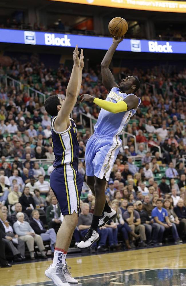 Denver Nuggets' J.J. Hickson, right, shoots as Utah Jazz's Enes Kanter, left, of Turkey, defends in the first quarter during an NBA basketball game Monday, Nov. 11, 2013, in Salt Lake City