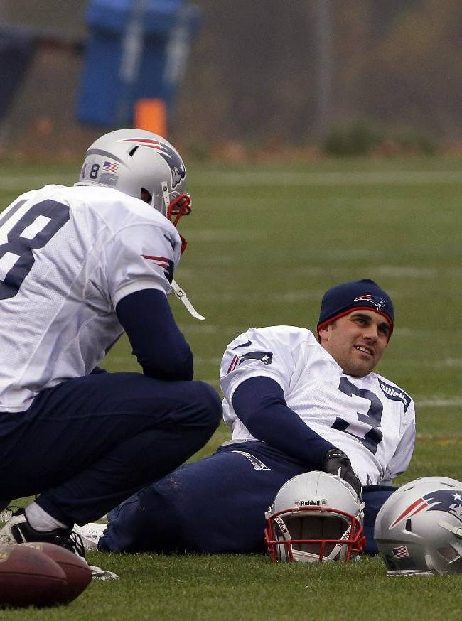 New England Patriots kicker Stephen Gostkowski (3) and long snapper Danny Aiken (48) talk during a stretching session before NFL football practice begins at the team's facility in Foxborough, Mass., Thursday, Oct. 31, 2013. The Patriots hosts the Pittsburgh Steelers on Sunday