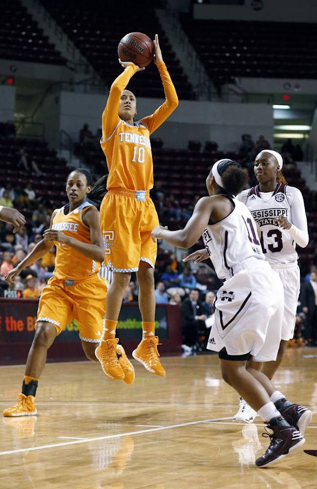 Tennessee guard Meighan Simmons (10) shoots over past Mississippi State defenders, including guard Katia May (11), during the second half of an NCAA college basketball game in Starkville, Miss., Thursday, Jan. 16, 2014. Tennessee won 67-63