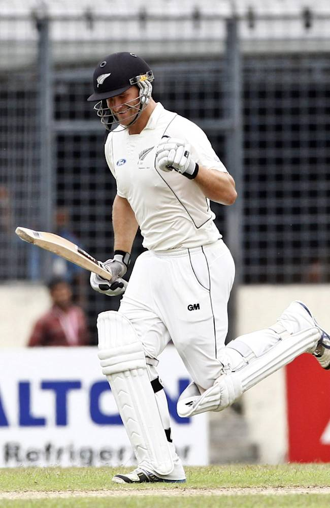 New Zealand's Corey Anderson celebrates after scoring a century on the third day of the second cricket test match against Bangladesh in Dhaka, Bangladesh, Wednesday, Oct. 23, 2013